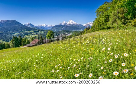 Panoramic view of beautiful mountain landscape in the Bavarian Alps with village of Berchtesgaden and Watzmann massif in the background, Nationalpark Berchtesgadener Land, Bavaria, Germany - stock photo