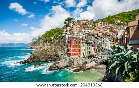 Panoramic view of beautiful Riomaggiore, one of the five famous fisherman villages of Cinque Terre in Liguria, Italy