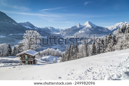Panoramic view of beautiful winter mountain landscape in the Bavarian Alps with the town of Berchtesgaden and Watzmann in the background at sunrise, Nationalpark Berchtesgadener Land, Bavaria, Germany - stock photo