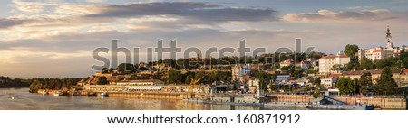 Panoramic view of Belgrade downtown, with Tourist port on Sava river, Kalemegdan fortress and dominant St. Michael's Cathedral bell tower on its skyline, Belgrade - Serbia.  - stock photo