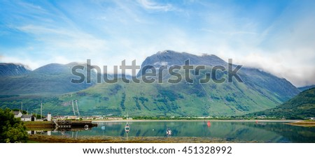 Panoramic view of Ben Nevis, the highest mountain in the British Isles, located at the Grampian Mountains in the Lochaber area of the Scottish Highlands, close to the town of Fort William and Loch Eil - stock photo