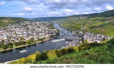 Panoramic view of Berncastel-Kues, a beautiful little town that straddles the river Mosel.  The town is surrounded by vineyards on the slopes of the river valley.
