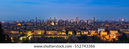 Panoramic view of Bologna, Italy at blue hour. Colorful sky over the historical city center with old buildings, the towers Asinelli and Garisenda, and Church