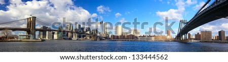Panoramic view of Brooklyn and Manhattan Bridges, New York City - stock photo