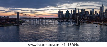 Panoramic view of Brooklyn Bridge at sunset in Manhattan, New York City - stock photo