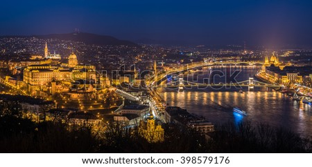 Panoramic View of Budapest with Street Lights and the Danube River at Twilight as Seen from Gellert Hill Lookout Point - stock photo