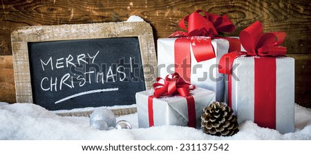 Panoramic view of Christmas gifts and slate on snow. - stock photo