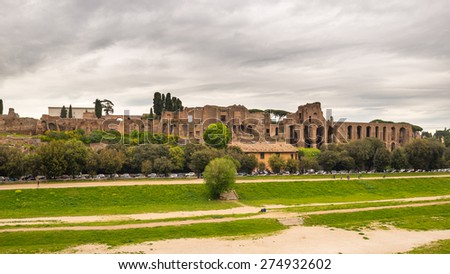 Panoramic view of Circo Massimo ruins in Rome city centre Italy, with dramatic cloudy sky in the background. - stock photo