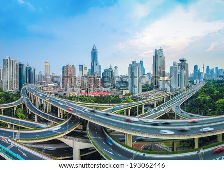 panoramic view of city elevated road junction at dusk in shanghai - stock photo