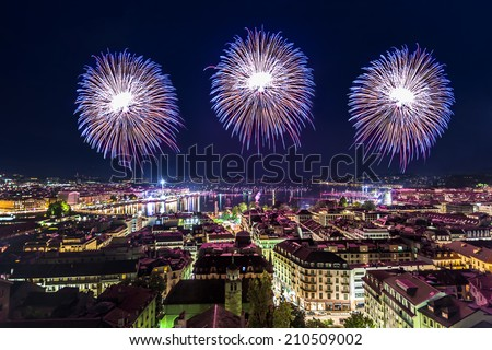 Panoramic view of city of Geneva, fireworks for the Swiss National Day - stock photo