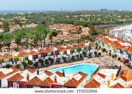 Panoramic view of coastline and tourist village with swimming pool in Playa del Ingles. Maspalomas. Gran Canaria.