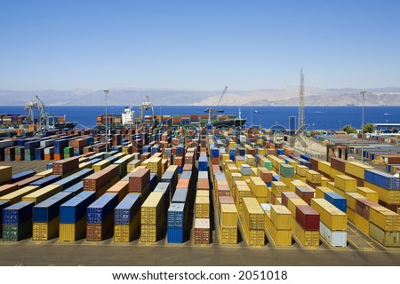 Panoramic view of containters in a harbour - stock photo