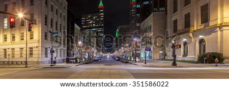 Panoramic view of downtown Raleigh, North Carolina at night from street level - stock photo