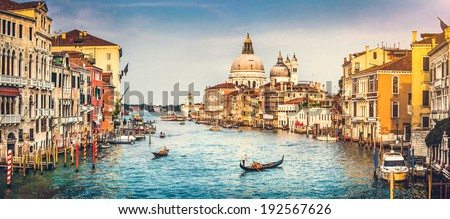 Panoramic view of famous Canal Grande and Basilica di Santa Maria della Salute at sunset in Venice, Italy with retro vintage Instagram style filter effect - stock photo