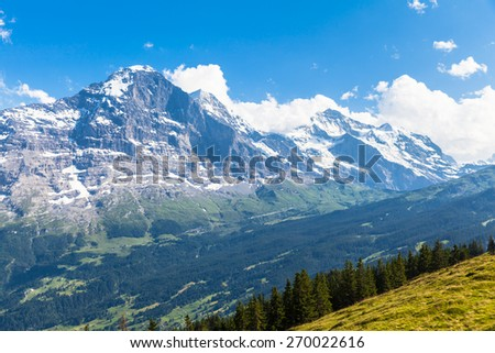 Panoramic view of famous peaks Eiger, Monch and Jungfrau, swiss alps on Bernese Oberland, Switzerland - stock photo