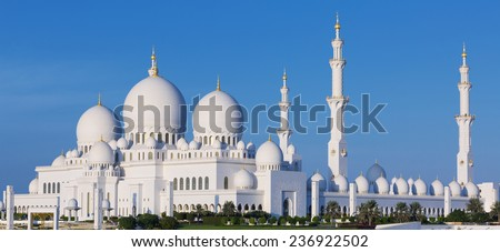 Panoramic view of famous Sheikh Zayed Grand Mosque with blue sky, UAE - stock photo