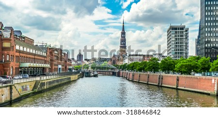 Panoramic view of famous Zollkanal with the historic St. Catherine's Church (Katharinenkirche), and old bridge in the Speicherstadt warehouse district of Hamburg, Germany - stock photo