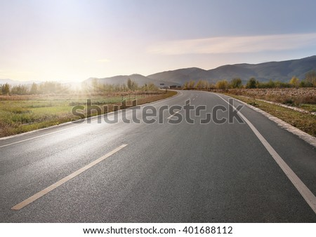 Panoramic view of foothills road with mountains - stock photo