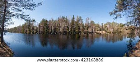 Panoramic view of forest river - stock photo