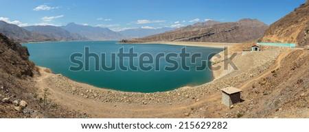 Panoramic view of Gallito Ciego reservoir dam in Peru. - stock photo