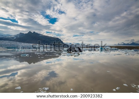 Panoramic view of glacier tongue and mountains in Iceland