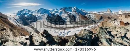 Panoramic view of Gorner Glacier and Matterhorn from Gornergrat - stock photo