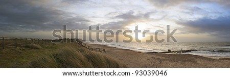 Panoramic view of Hengistbury Head from Southbourne at sunrise - stock photo