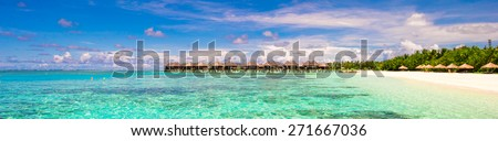 Panoramic view of iidyllic tropical beach with white sand and perfect turquoise water - stock photo