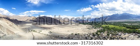 Panoramic view of Indus Valley from Thikse Gompa in Ladak, India. Indus River is one of the longest rivers in Asia and is the backbone of Ladakh. All the major places are situated close to the river. - stock photo