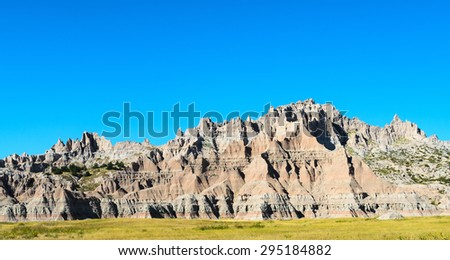 Panoramic View of Jagged Rock Formations at Badlands National Park - stock photo
