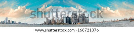 Panoramic view of Jersey City, Lower Manhattan and Brooklyn Bridge from Governors Island- New York. - stock photo