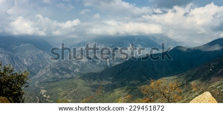 panoramic view of Kings Canyon National Park under a beautiful cloudscape, California, USA - stock photo