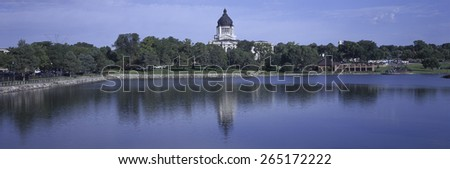 Panoramic view of lake with view of South Dakota State Capitol and complex, Pierre, South Dakota, built between 1905 and 1910 - stock photo