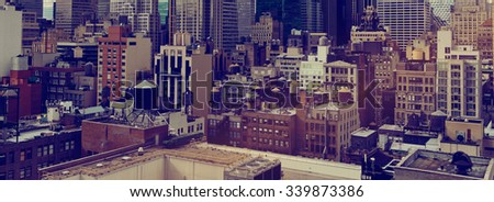 Panoramic View of Low Rise Rooftops and Skyscrapers in New York City, New York, USA with Sepia Toned Filter for Vintage Feel - stock photo