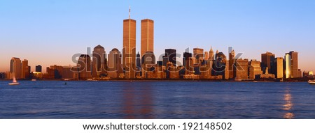 Panoramic view of lower Manhattan and Hudson River, New York City skyline, NY with World Trade Towers at sunset - stock photo
