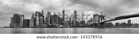 Panoramic view of Manhattan Bridge and skyline in New York City. - stock photo