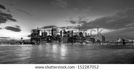 Panoramic view of Manhattan in New York city from Brooklyn bridge park at dusk in a cloudy day, United States. - stock photo