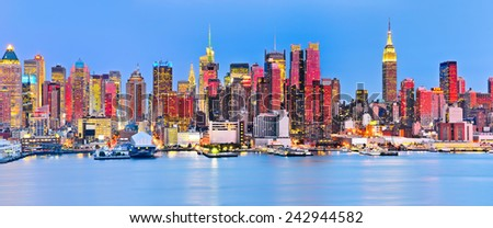 Panoramic view of Manhattan skyline with red sunlight reflection. - stock photo