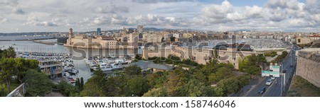 Panoramic view of Marseille ald city port vieux and fort saint jean from Fort sain Nicolas - France - stock photo