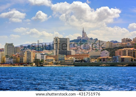 Panoramic view of Marseille, France, with Basilica Notre Dame de la Garde on the hill - stock photo