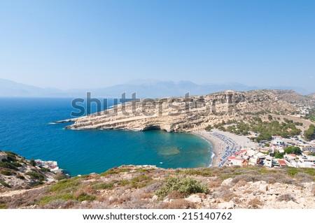 Panoramic view of Matala sandy beach and village near Heraklion on the island of Crete, Greece. - stock photo