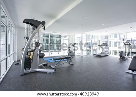 Panoramic view of modern style gym interior - stock photo