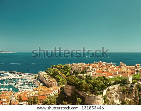panoramic view of Monaco with Prince's Palace and harbor. vintage postcard style - stock photo