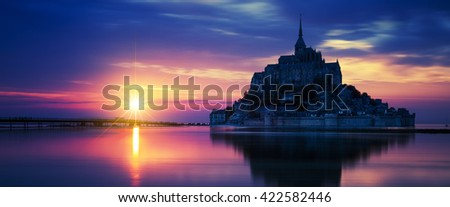 Panoramic view of Mont-Saint-Michel at sunset, France. - stock photo