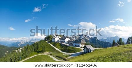 panoramic view of monte lussari, small mountain village, italy - stock photo