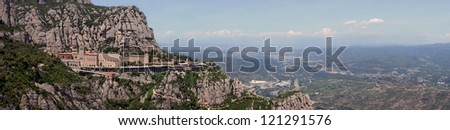 Panoramic view of Montserrat Monastery is a Benedictine Abbey high up in the mountains near Barcelona, Catalonia, Spain - stock photo