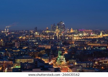 Panoramic view of Moscow City business complex, Stalin skyscrapers, residential buildings and churches at night in Moscow, Russia