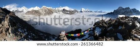 Panoramic view of Mount Everest, Lhotse, Cho Oyu Makalu from Gokyo Ri vith prayer flags - Khumbu valley, sagarmatha national park - Nepal - stock photo
