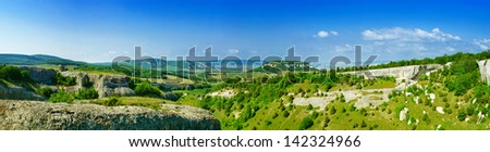 Panoramic view of mountain summer landscape with clouds and green hills (Crimea) - stock photo