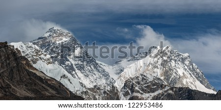 Panoramic view of Mt. Everest (8848 m) and Lhotse-Nuptse massif from the Ngozumba Tsho ( the fifth Gokyo lake ) - Nepal, Himalayas - stock photo